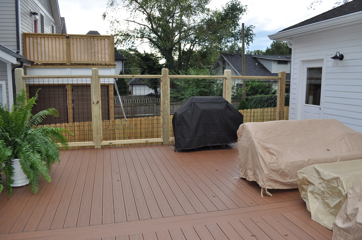 deck with plant and covered grill