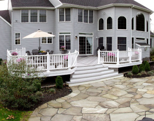back patio upgraded deck with white railings