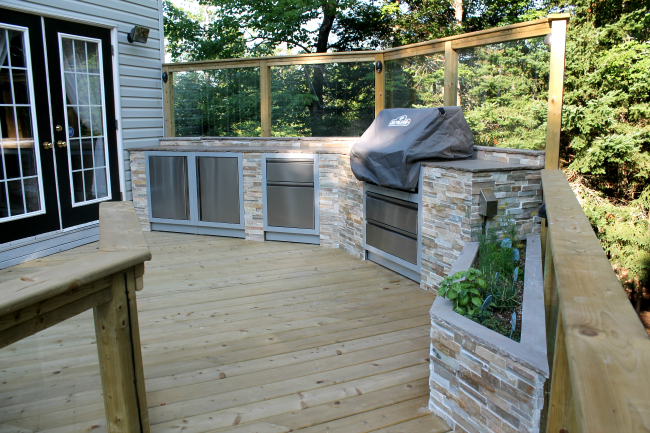 Outdoor patio deck with kitchen