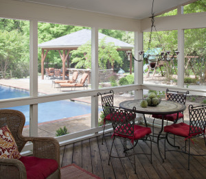 screened in porch with view of outdoor pool