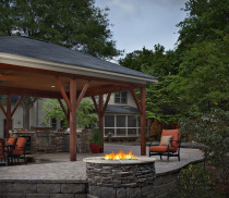 covered patio with chairs and firepit