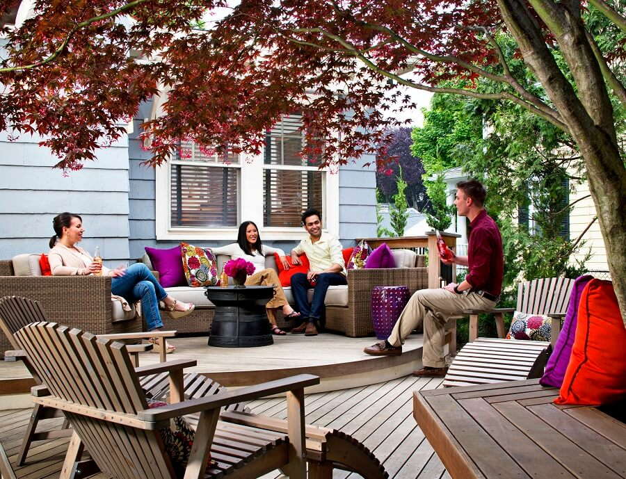 people socializing on outdoor deck furniture