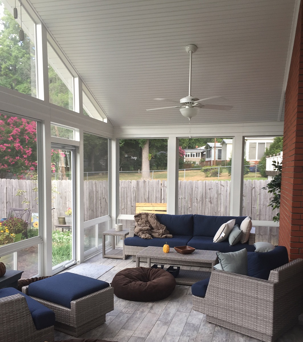 airy sunny porch with vaulted ceiling