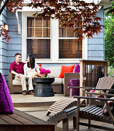 Couple hanging out on cozy deck