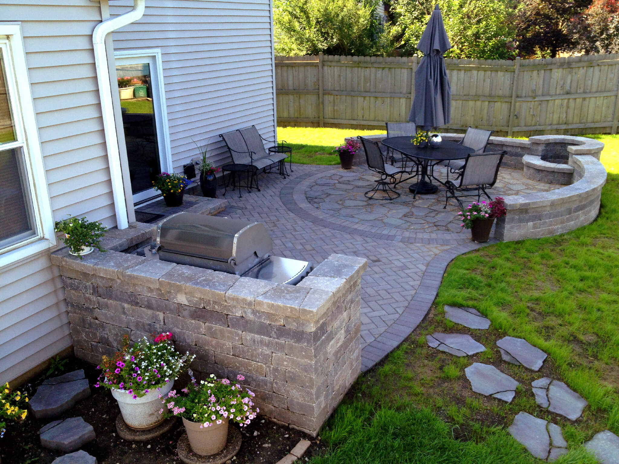 Patio with outdoor kitchen and fire pit