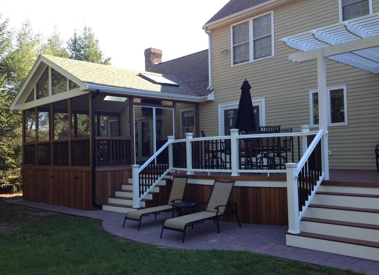 Screened porch and wood deck with railing