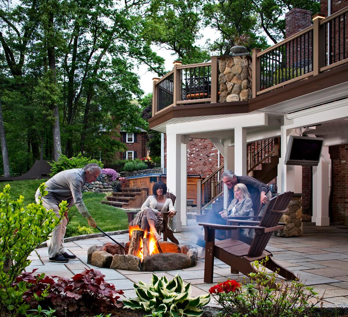 Family enjoying fire pit on patio