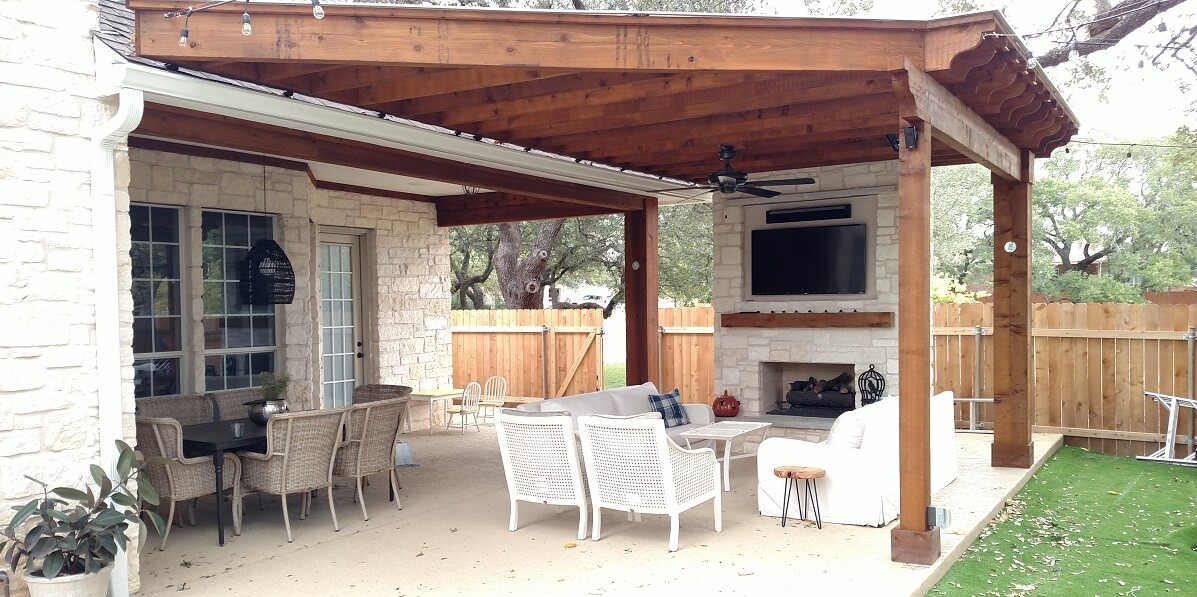 covered patio with fire place