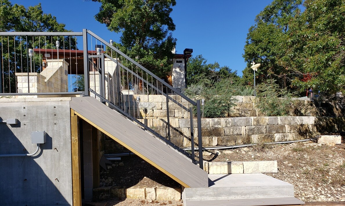Wood deck stairs with railing