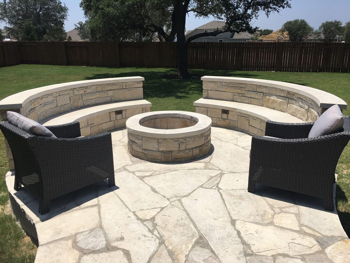 Custom patio with fire pit and seat wall