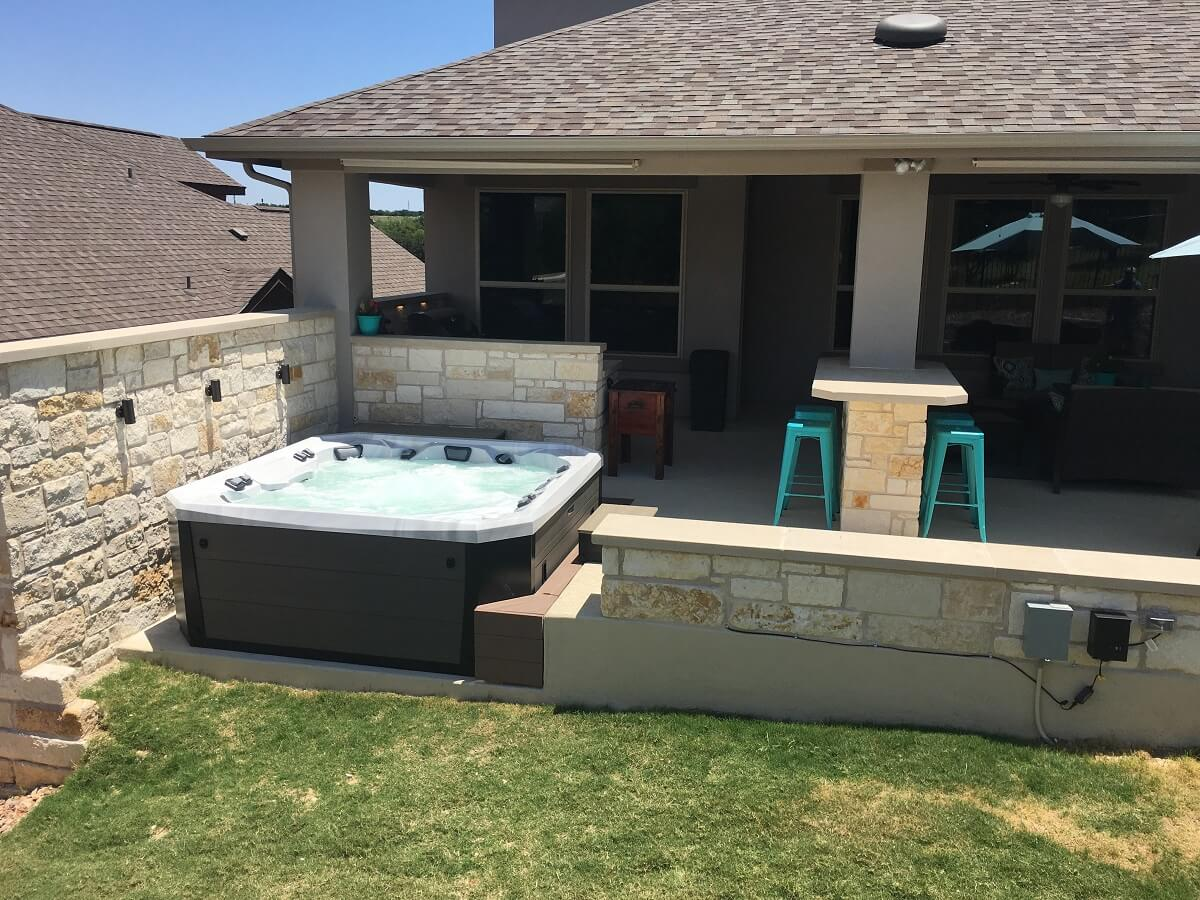 Outdoor space with spa deck