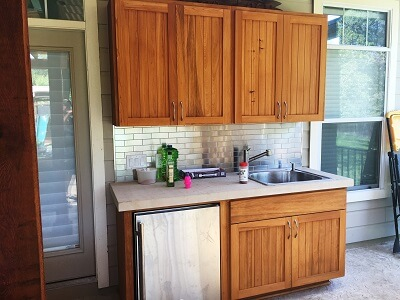 Custom outdoor kitchen cupboard and sink
