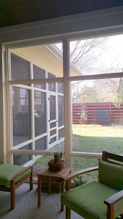 Screened porch with seating area