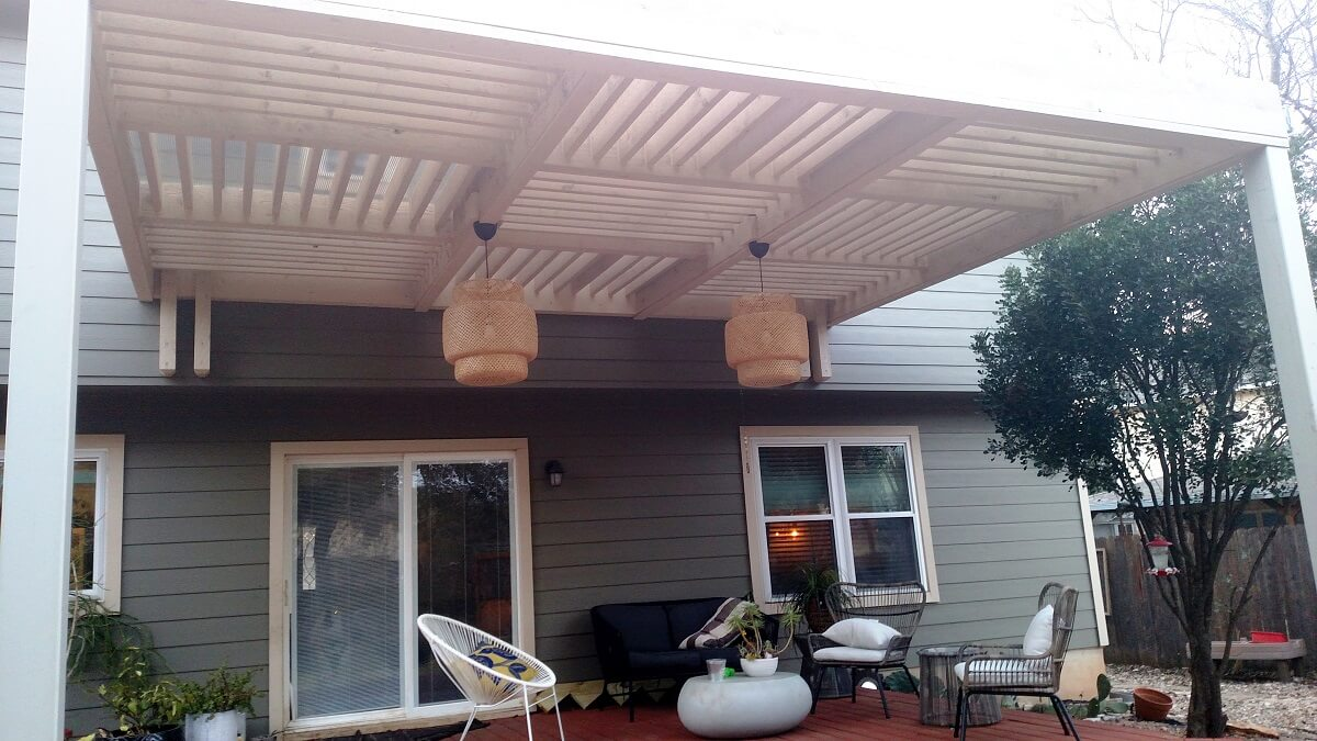 Backyard deck with pergola and light fixtures