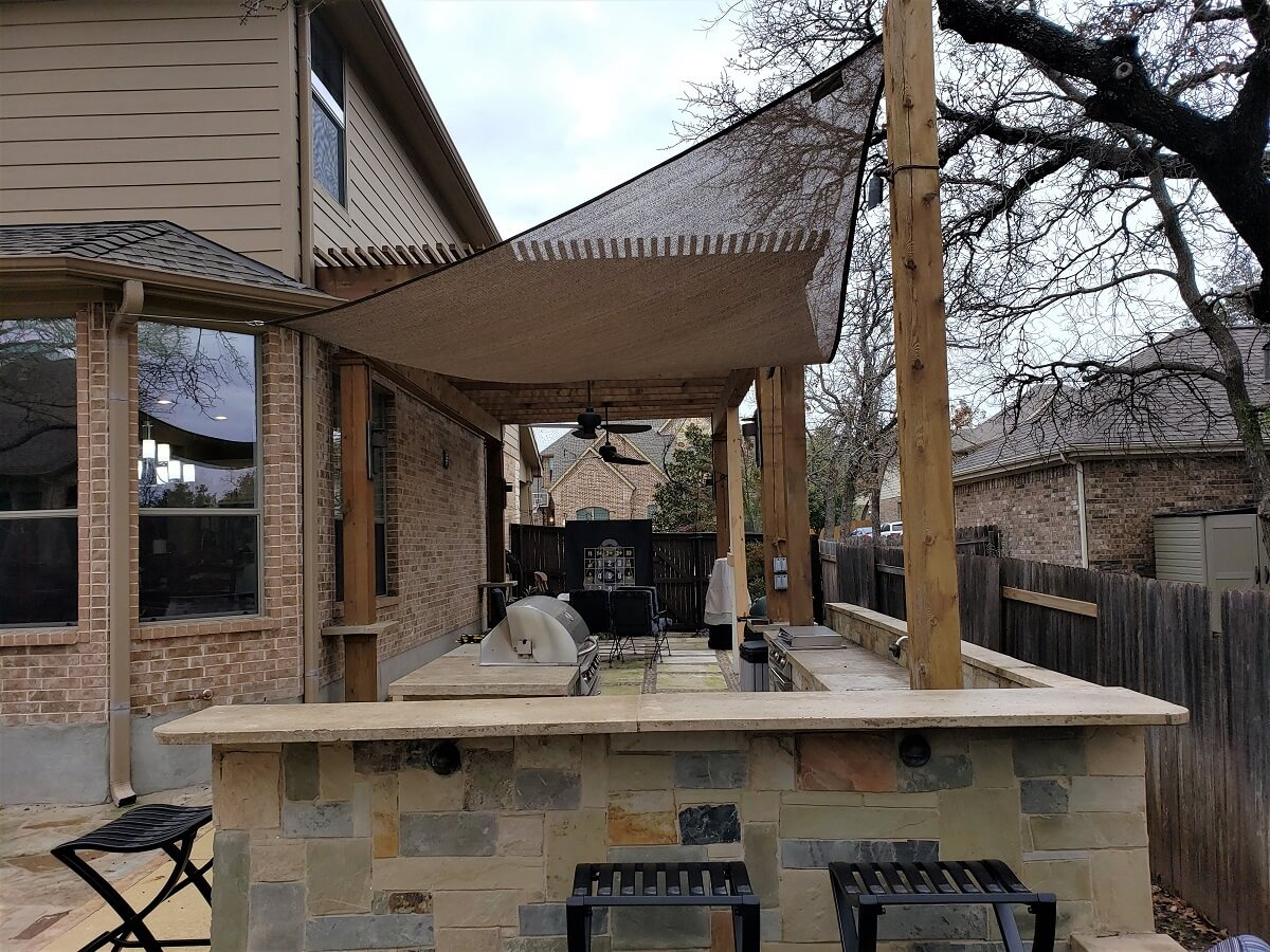 Pergola covered patio with outdoor kitchen