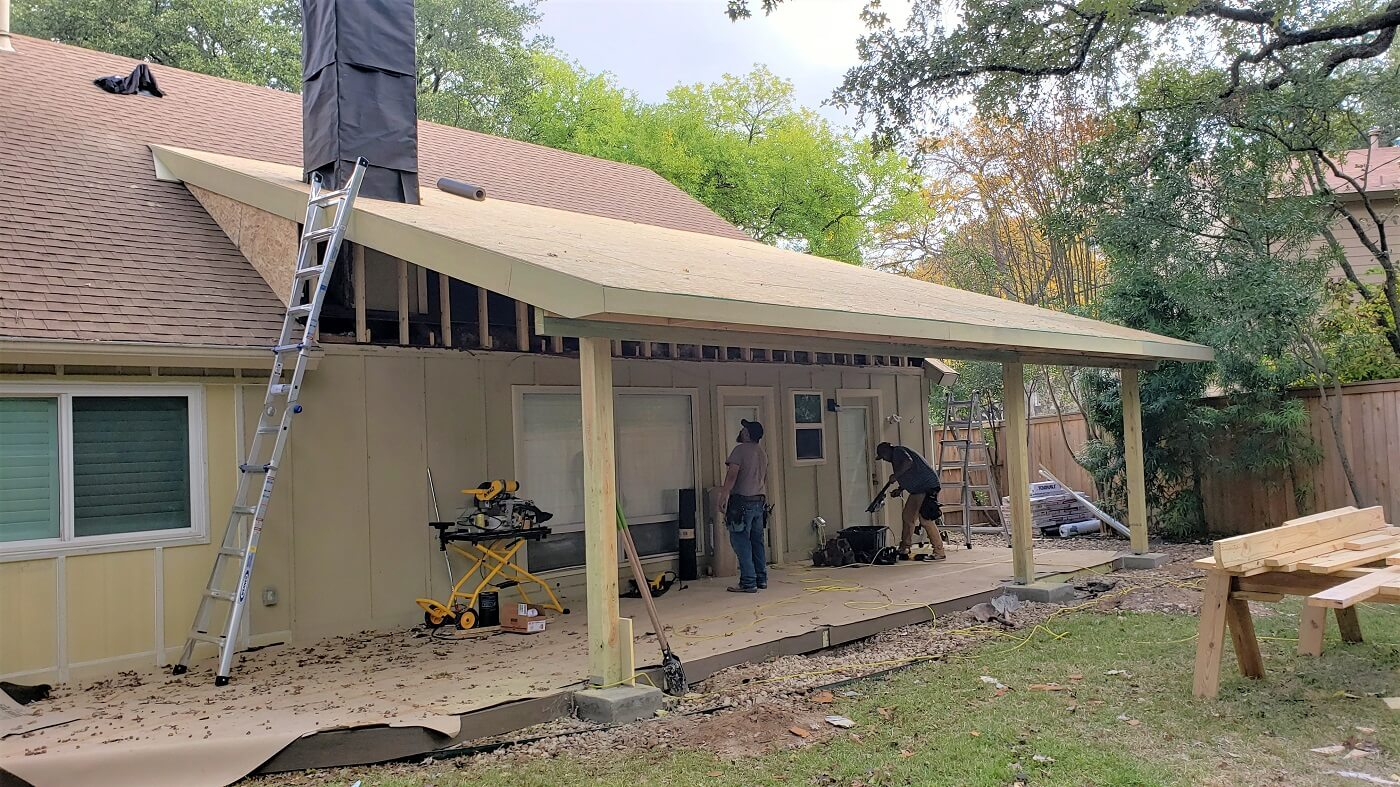 Men working on new porch and deck