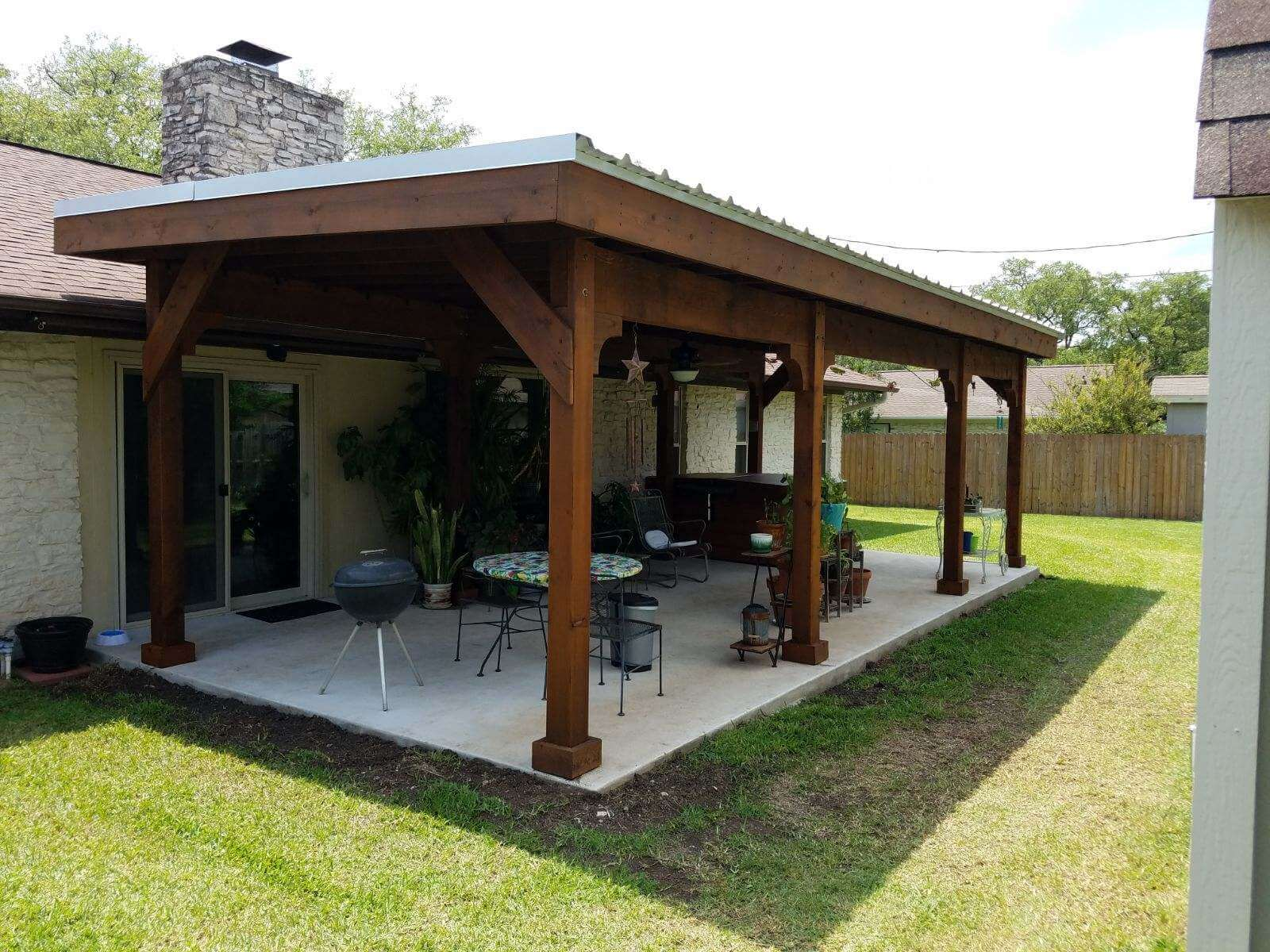 Outdoor kitchen on patio with pergola