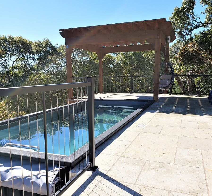 Custom pool deck with pergola