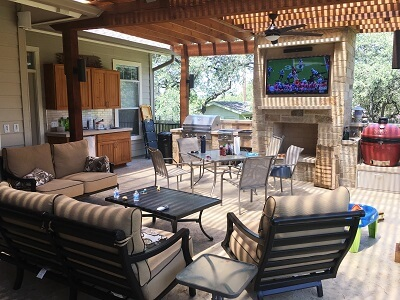 Covered patio with outdoor kitchen and entertainment area