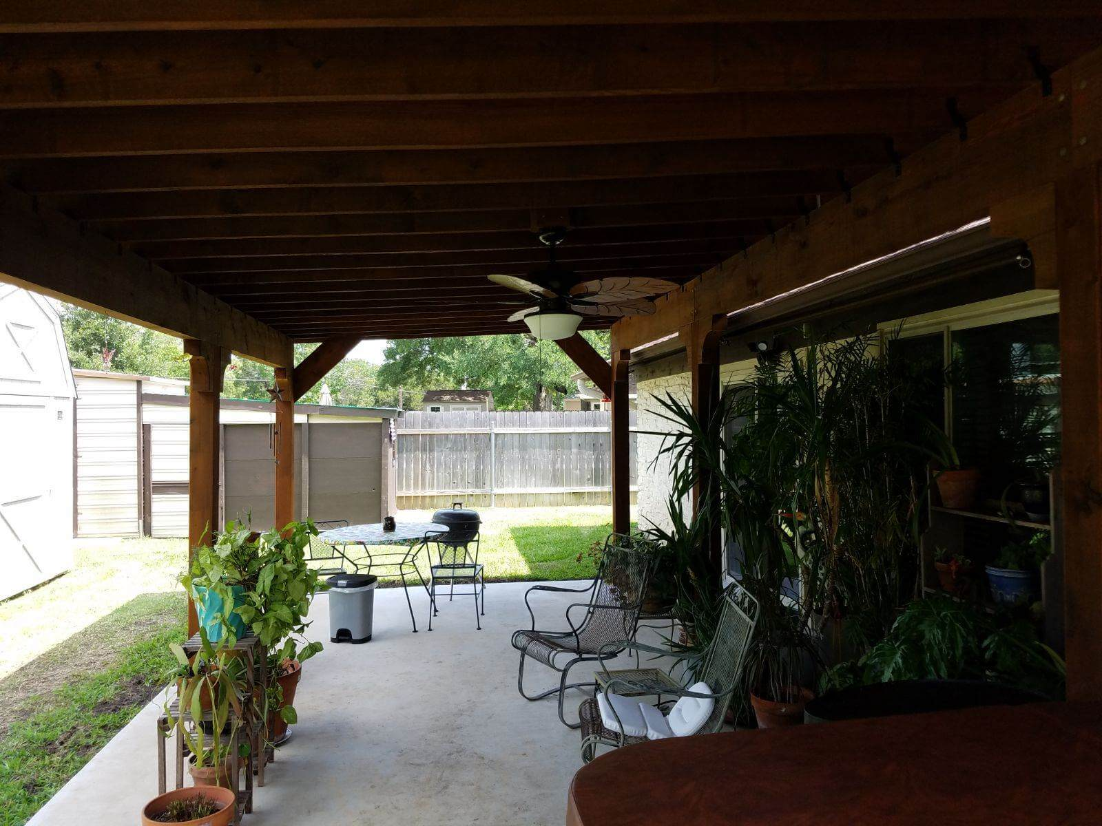Pergola with ceiling fan over backyard patio