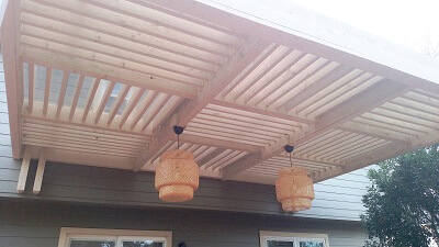 Pergola on deck with light fixtures