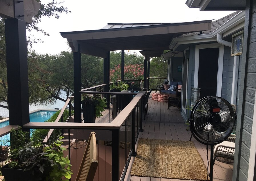 Wood deck with pool and river view