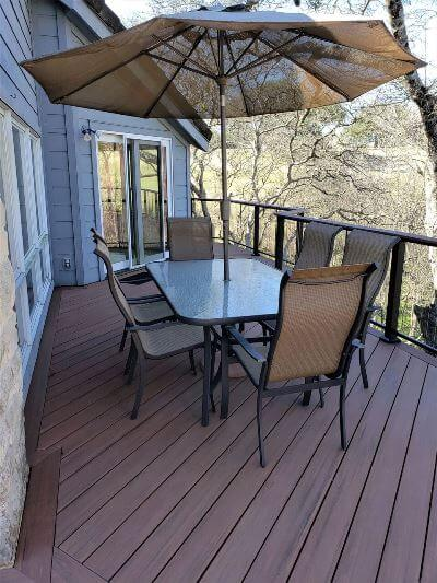 Wood deck with railing and seating area