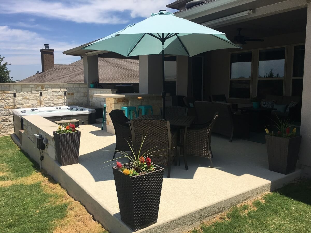 Outdoor space with spa deck and seating area