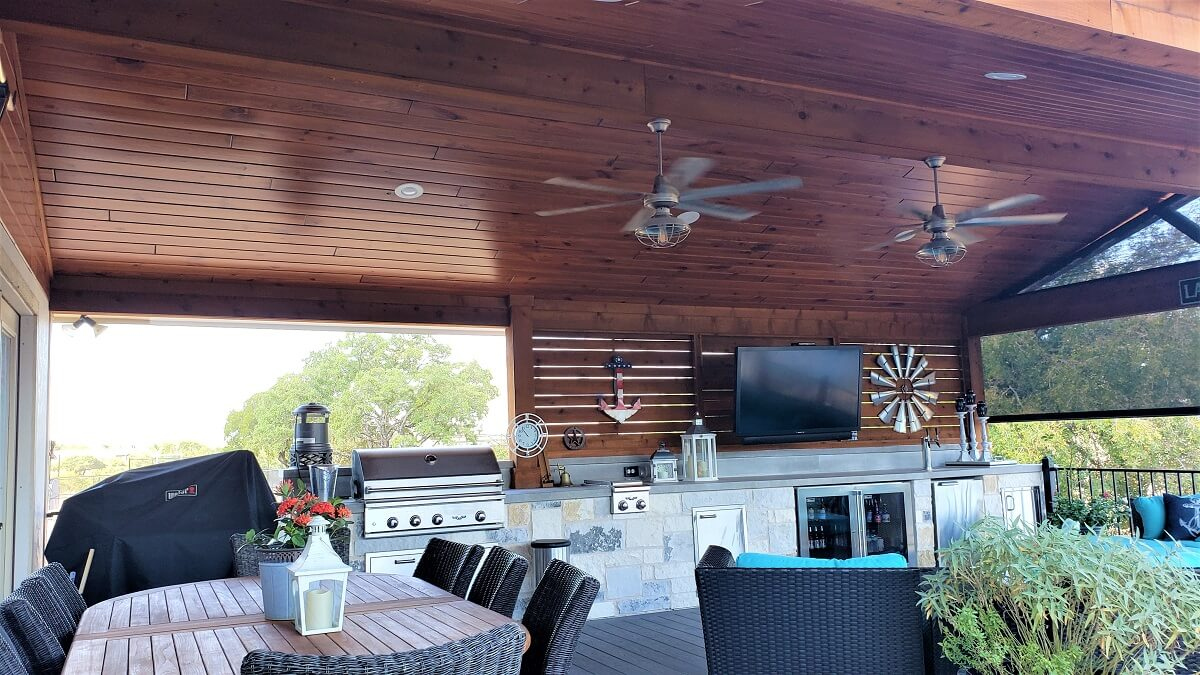 Custom outdoor kitchen and dining area on deck