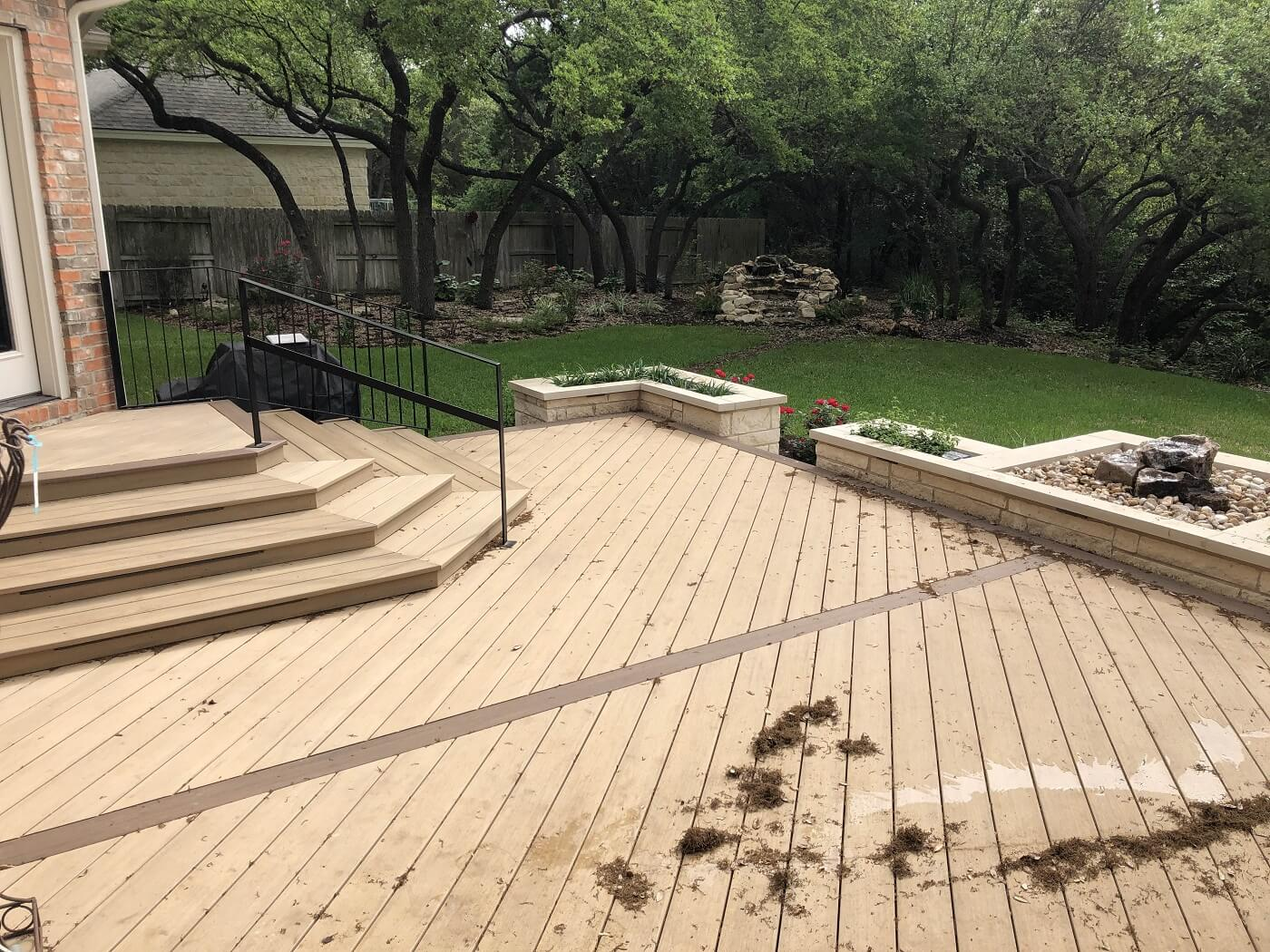 Backyard deck with lighting and railing
