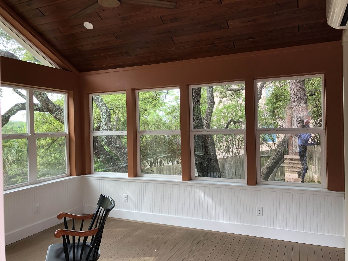 Interior view of sunroom with rocking chair