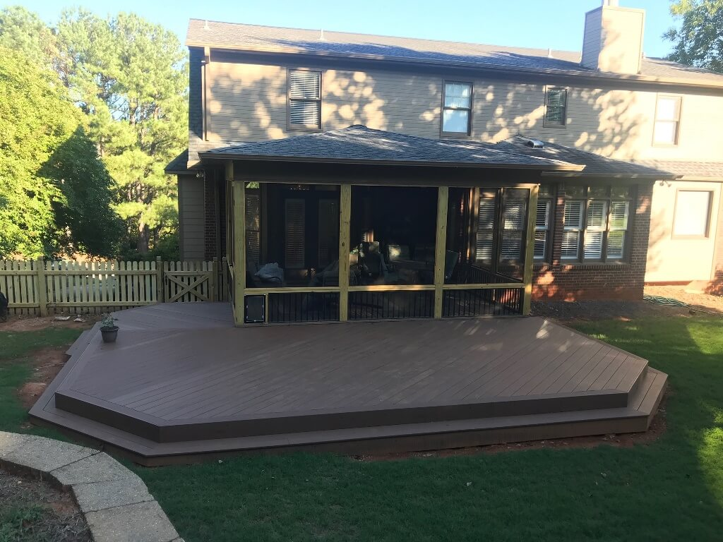 Custom backyard screened porch and wood deck