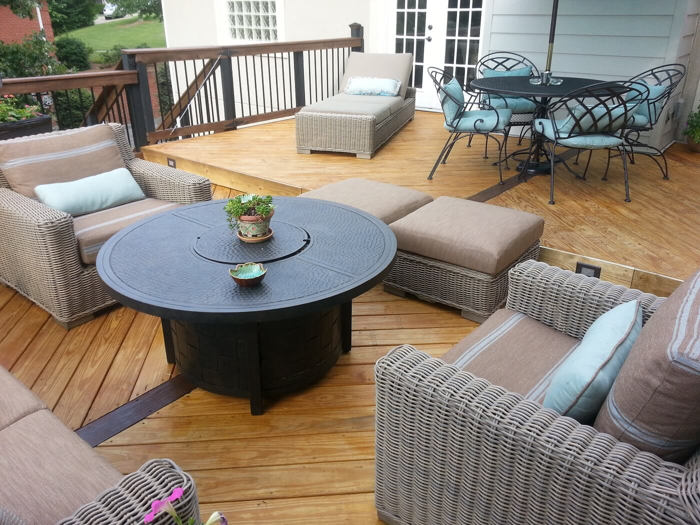 Custom wood deck with balusters and lounge area