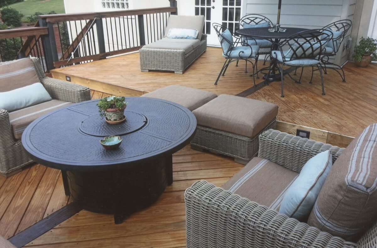 Wood deck with balusters, gate and lounge area