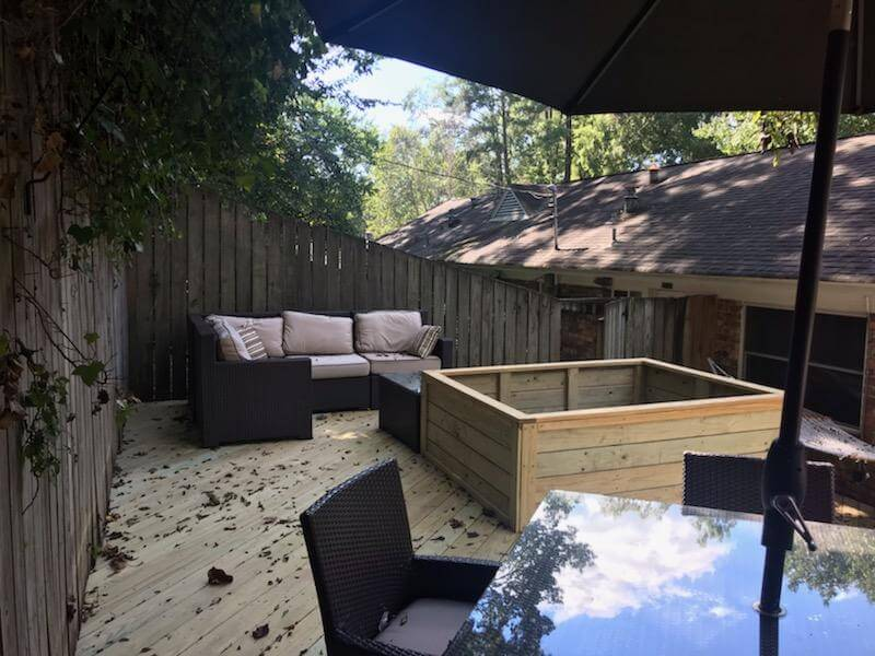Custom deck with seating area and open planter box