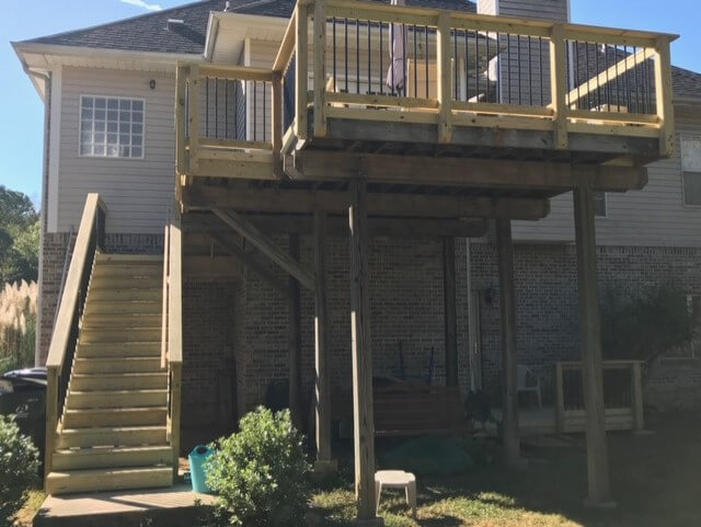 Custom backyard wood deck with staircase