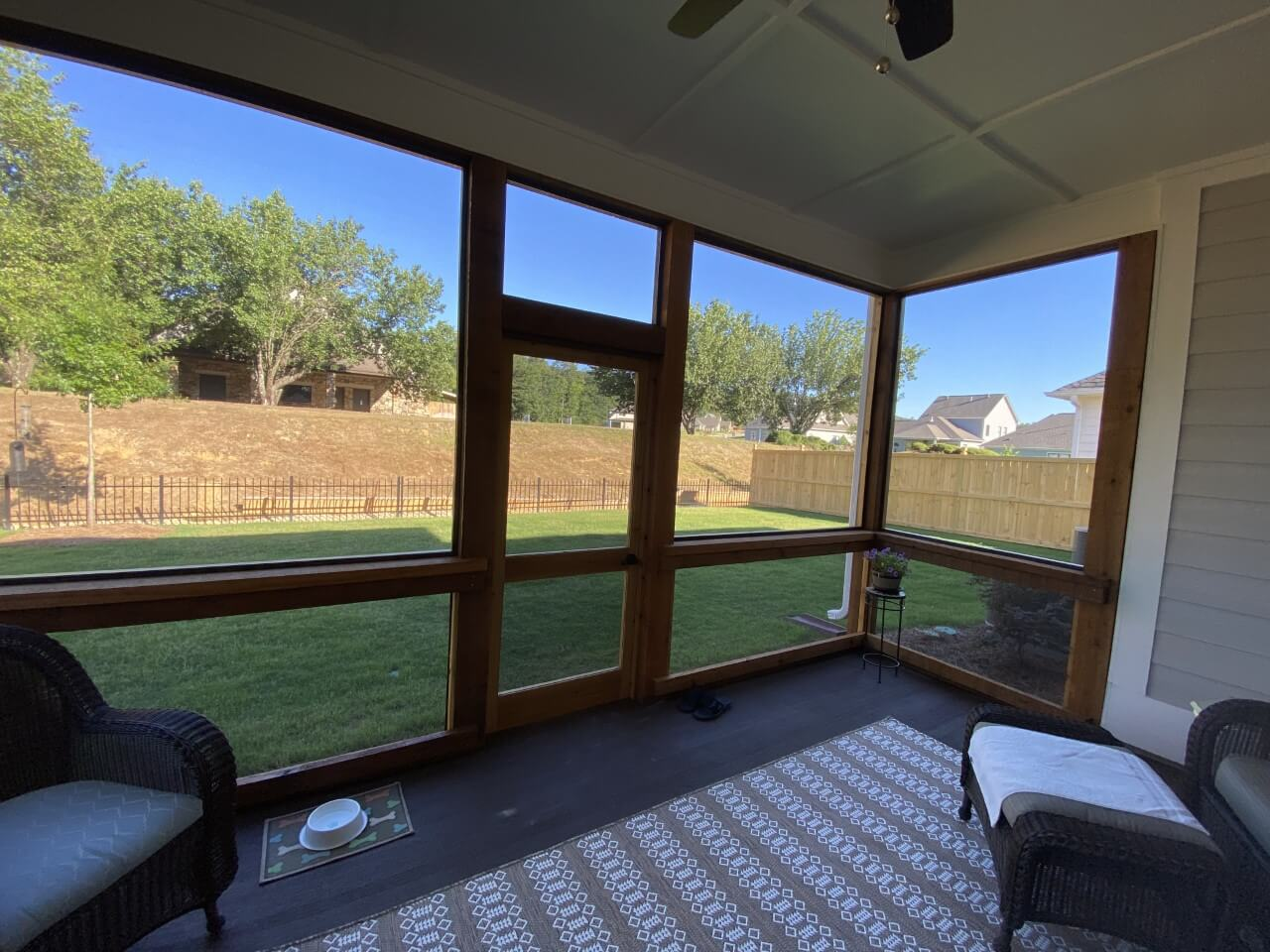 Backyard view from inside of screened porch