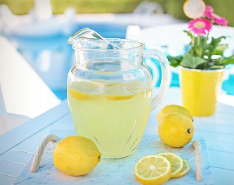 Pitcher of lemonade and lemons