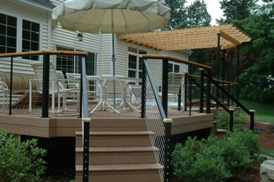 Cheshire, CT, low maintenance deck with sleek cable rail and wooden pergola