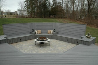 built in deck with seating and fire feature in the middle
