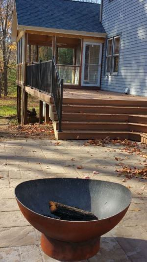 Screened porch, deck and patio with fallen leaves around
