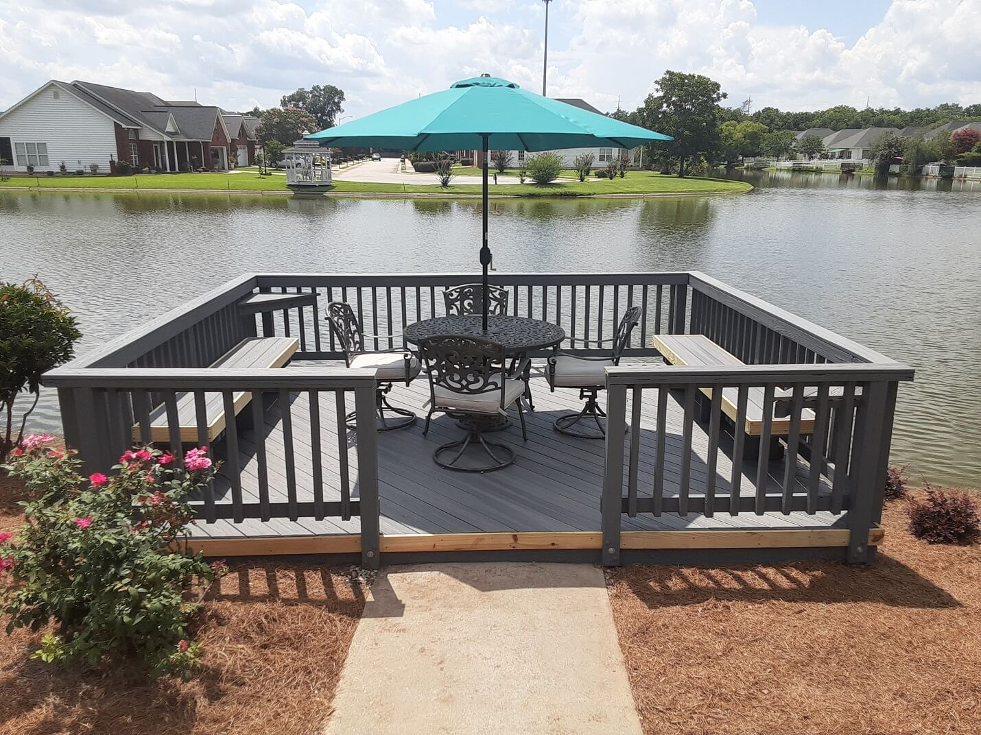 Custom dock with seating area overlooking water