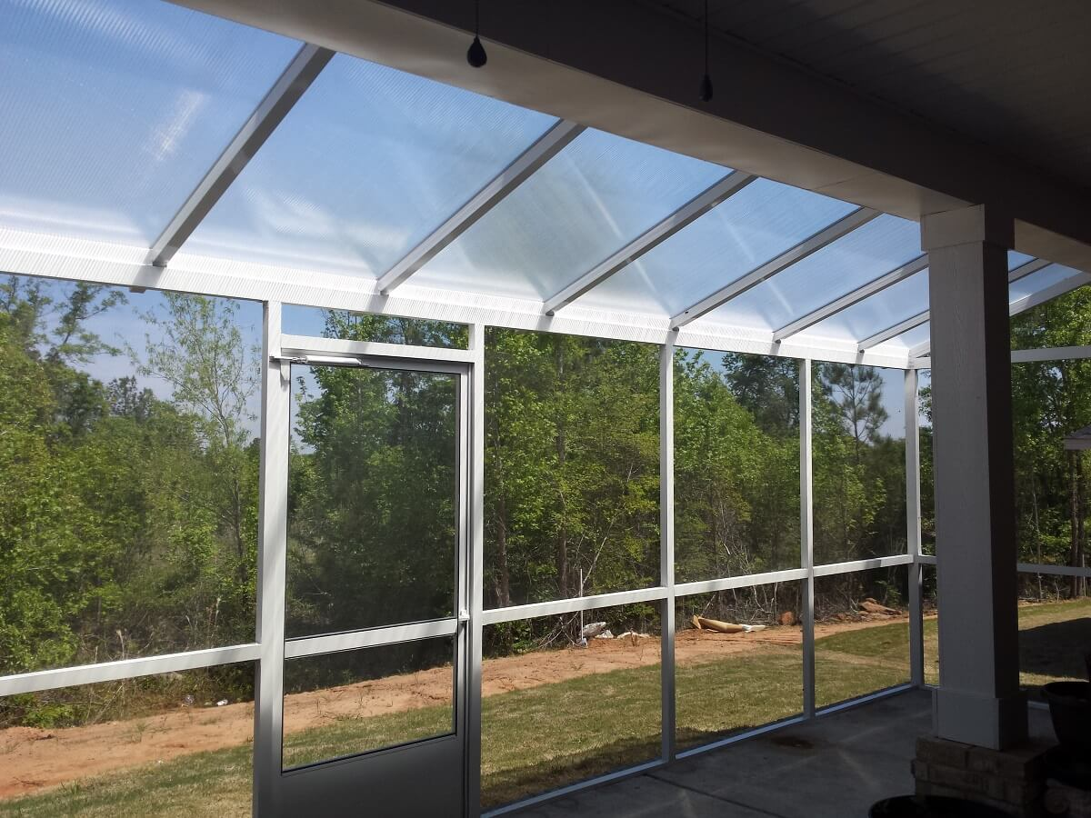 Interior of screened porch with backyard view