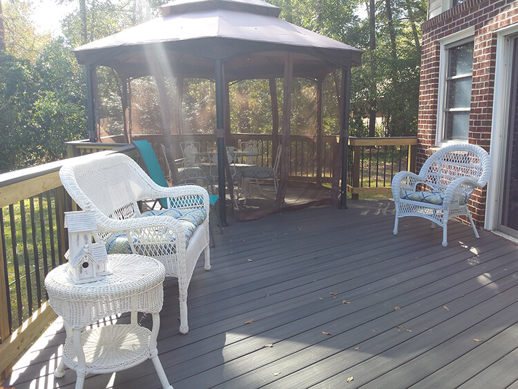 Wood deck and screened porch with seating area