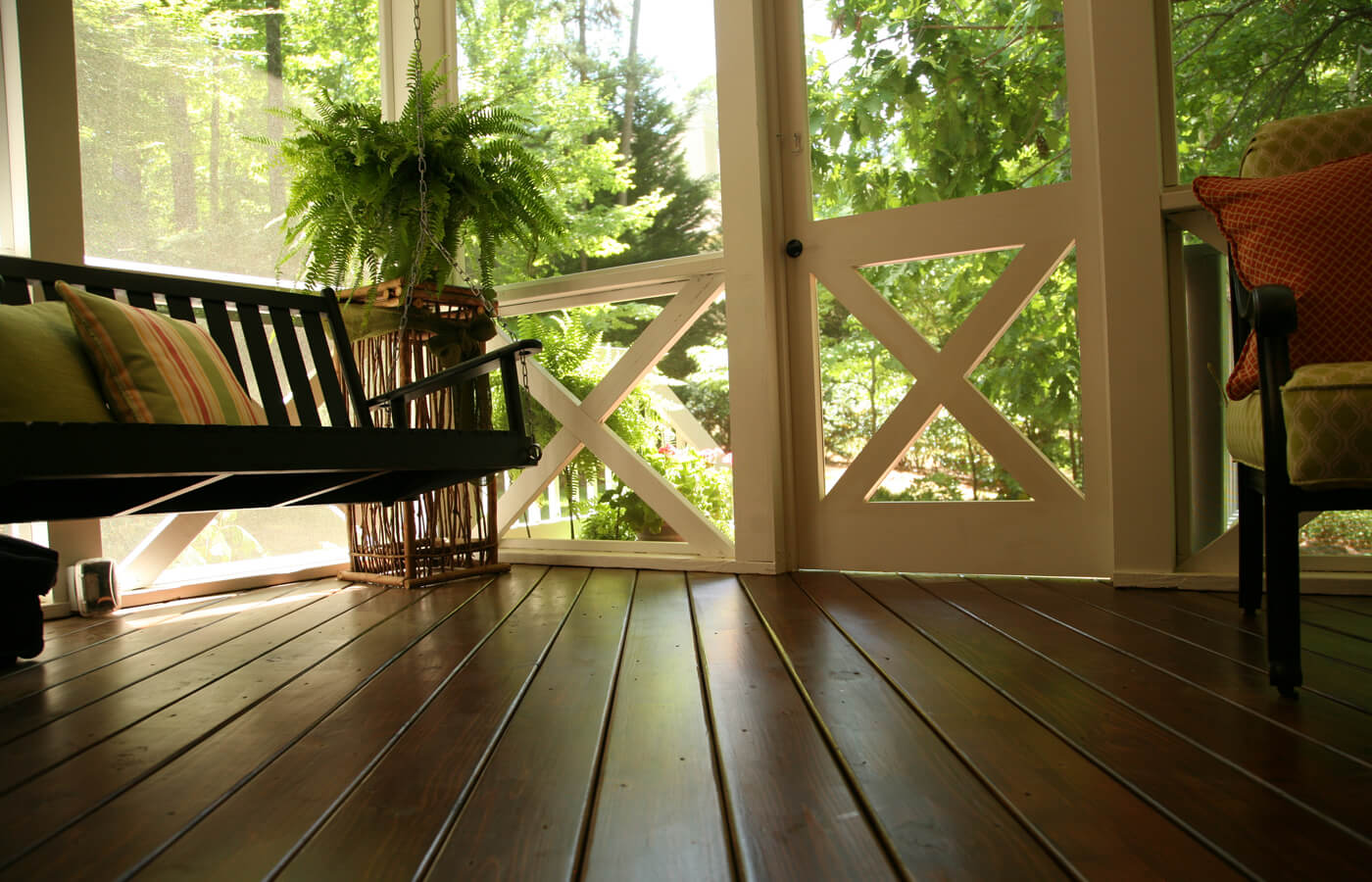 Covered porch with stained wood floor