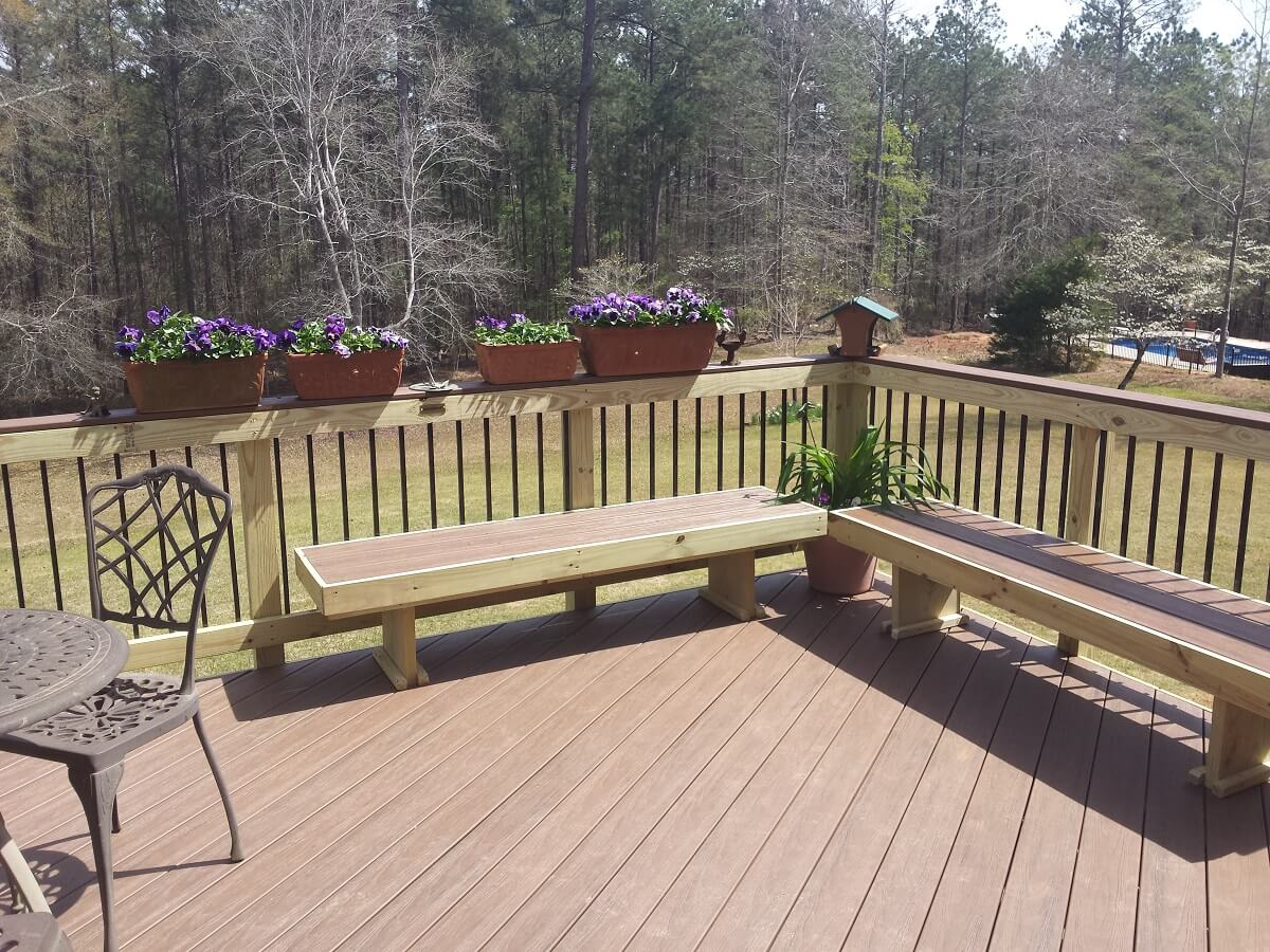 Custom deck with planter boxes and floating benches