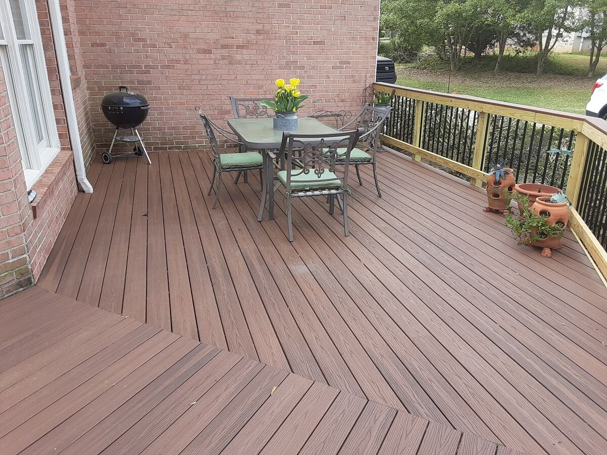 Custom wood deck with dining area and outdoor kitchen