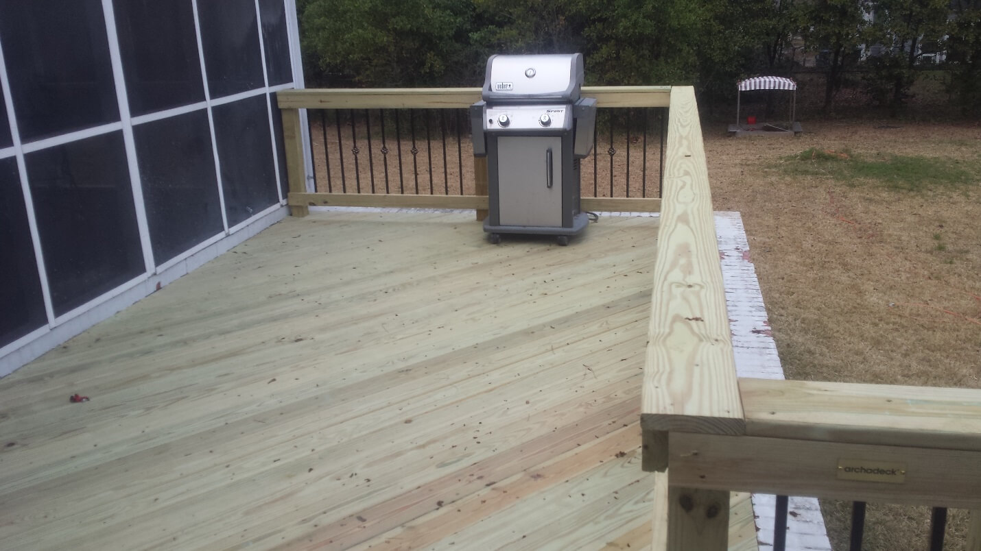 Custom wood deck with outdoor kitchen