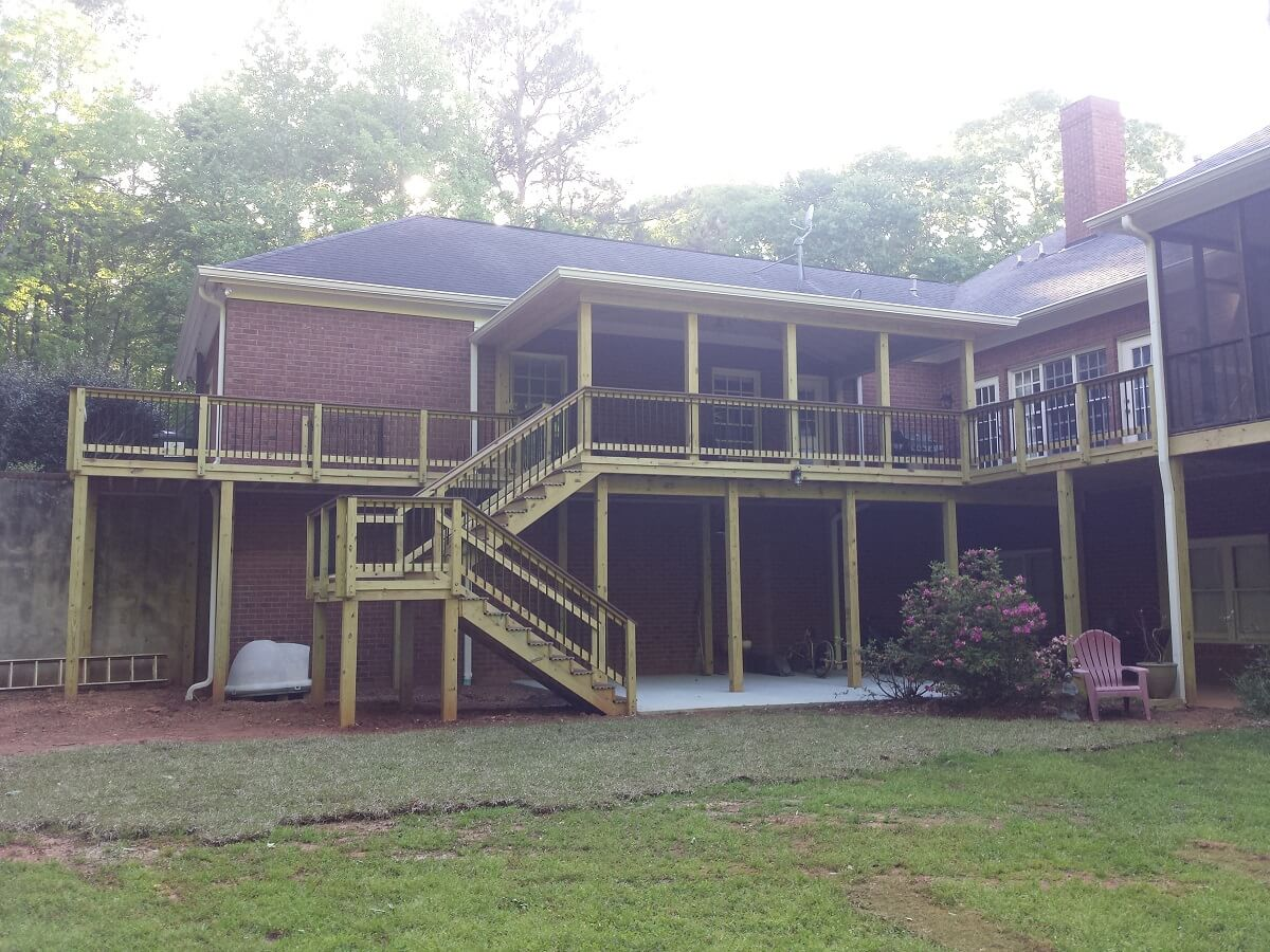 Custom backyard elevated screened porch and deck