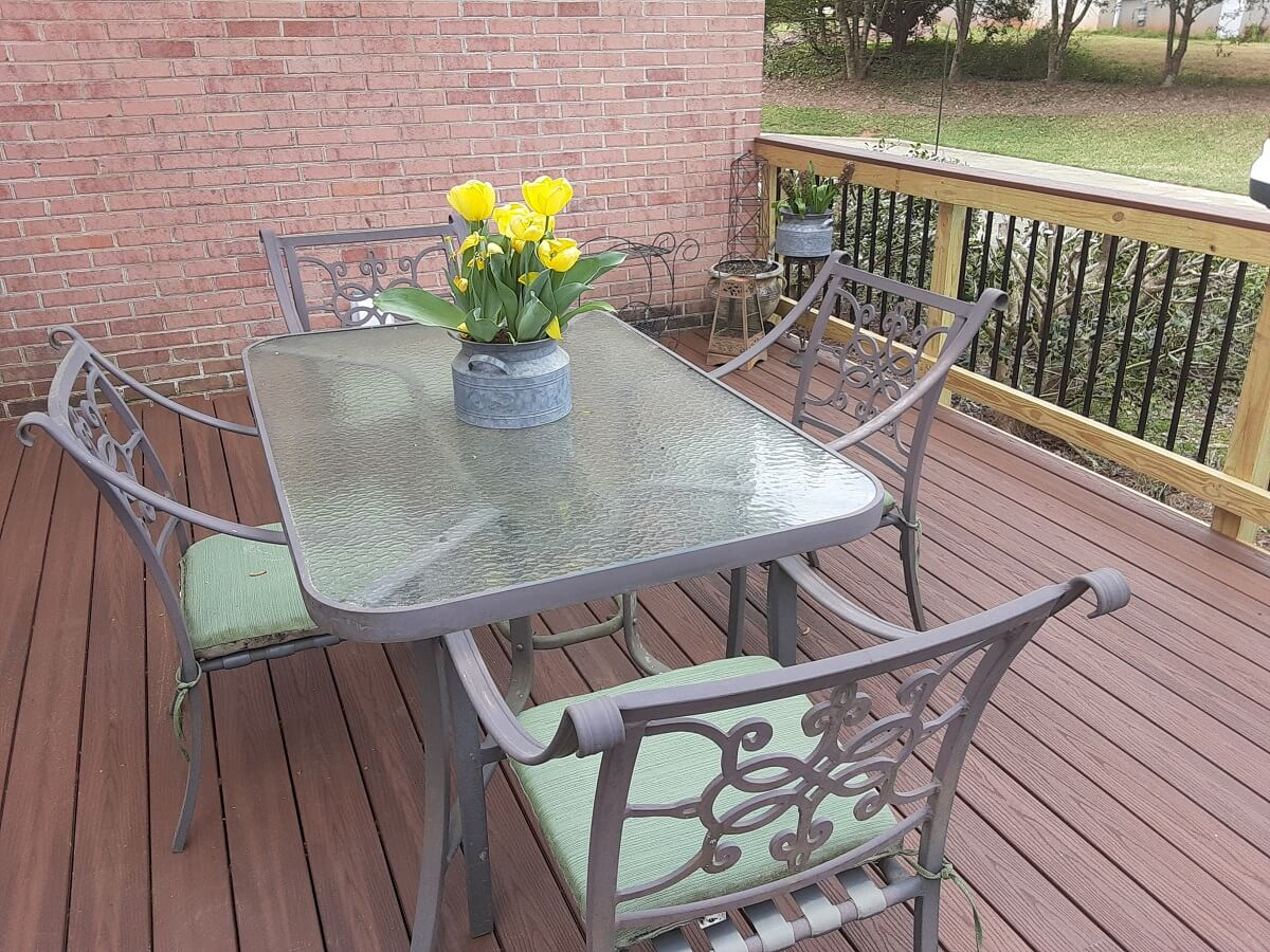 Dining area with flower decor on new wood deck